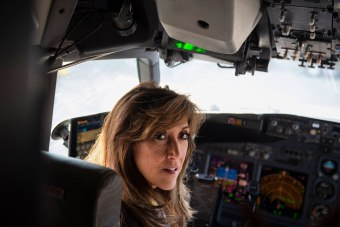 Pilot Tammie Jo Shults poses for a portrait in the cockpit of an airplane on Wednesday, August 1, 2018 at the San Antonio International Airport.